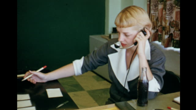 stockvideo's en b-roll-footage met 1955 ms secretary speaking on phone, wearing headset / toronto, canada - 1955