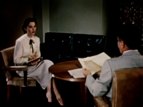 1956 WS Secretary taking dictation from boss in office / USA