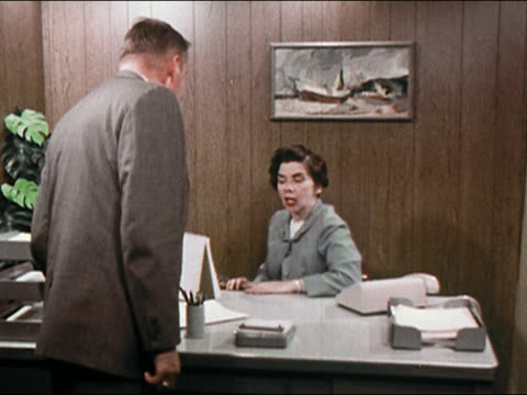 1969 secretary typing at desk speaking sternly to boss / shooing him away from desk - secretary stock videos & royalty-free footage