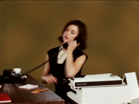 1967 secretary typing in studio / answers phone + writes note / industrial - vergangenheit stock-videos und b-roll-filmmaterial