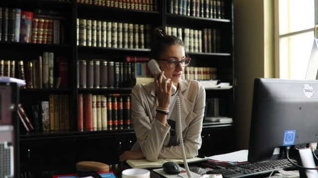 secretary using a phone in the office - librarian stock videos & royalty-free footage