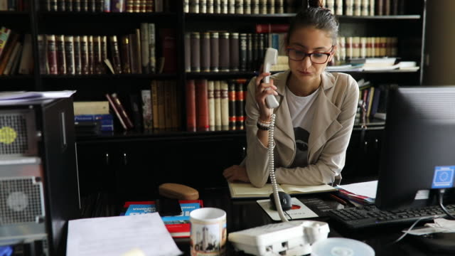 secretary using a phone in the office - lip ring stock videos and b-roll footage