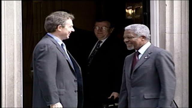 UN SecretaryGeneral Kofi Annan visit / New cabinet arrivals ITN London Downing Street Car along Kofi Annan out of car greeted by Tony Blair MP pose...