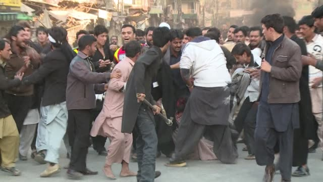 sectarian clashes in pakistans garrison city rawalpindi left seven people dead and over 30 injured on friday as worshippers massed to mourn the... - prophet stock videos and b-roll footage