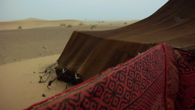 ms section of bedouin tent in windy desert/ morocco - tent stock videos and b-roll footage