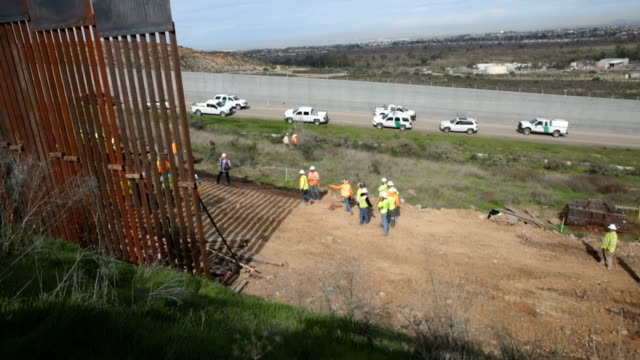 section of border wall is constructed on the u.s. side of the border on january 28, 2019 in tijuana, mexico. the u.s. government had been partially... - geographical border stock videos & royalty-free footage
