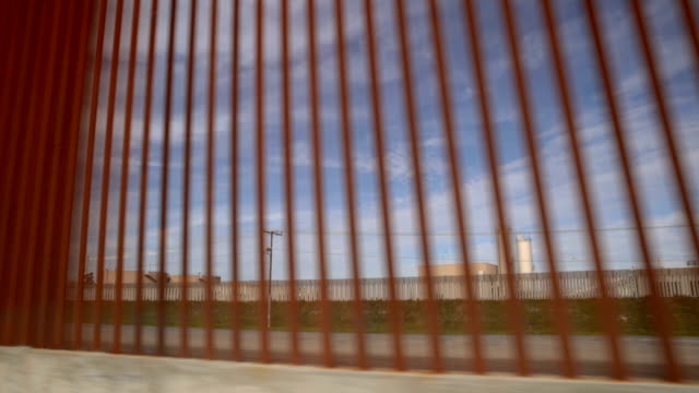 section of border wall is constructed on the u.s. side of the border on january 28, 2019 in tijuana, mexico. the u.s. government had been partially... - 国境の壁点の映像素材/bロール
