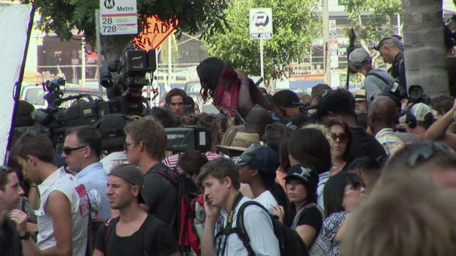 section of crowd and cameramen standing outside the staples center before michael jackson memorial service/ ms female fan outside the staples center... - conceptual symbol stock videos and b-roll footage