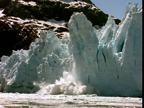slo mo, ms, section of glacier crumbling and sliding into water, margerie glacier, glacier bay national park, alaska, usa  - 1990 stock videos & royalty-free footage