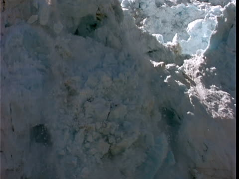 SLO MO, MS, Section of glacier crumbling and sliding into water, Margerie Glacier, Glacier Bay National Park, Alaska, USA