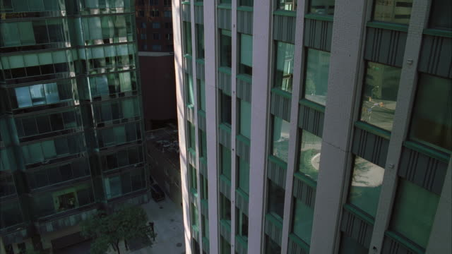 ms ha section of high-rise buildings - fensterfront stock-videos und b-roll-filmmaterial