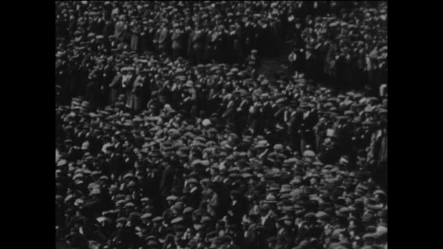 section of the crowd at the kennington oval in london during the county championship cricket match between surrey and middlesex, 8th august 1925. - oval kennington stock videos & royalty-free footage