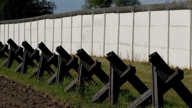 section of the former, cold war-era fortified border between east germany and west germany stands as a memorial on september 18, 2019 at... - surrounding wall video stock e b–roll