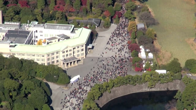 a section of the imperial palace grounds known as the inui road was opened to the public wednesday to commemorate emperor akihito's 80th birthday... - emperor of japan stock videos and b-roll footage