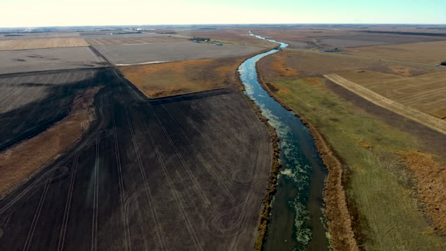 sectioned off farmland with stream - south dakota stock videos & royalty-free footage