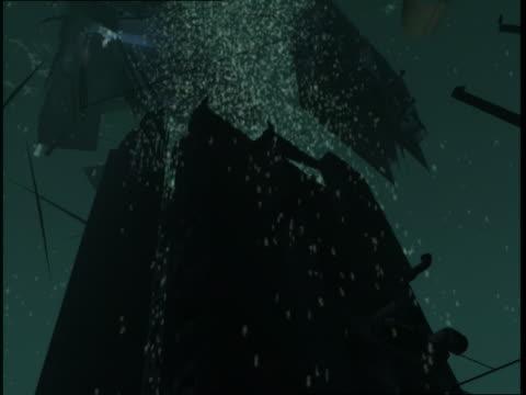 vidéos et rushes de sections and pieces of rms titanic separate as it descends toward the seafloor. - titanic