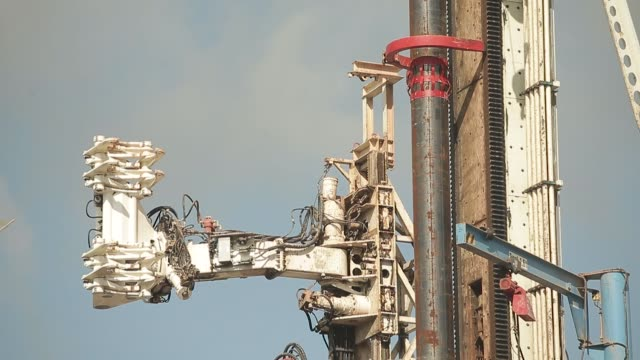 sections of pipe are lowered on the drilling platform at the preston new road pilot gas well site operated by cuadrilla resources ltd near blackpool... - u bahnsteig stock-videos und b-roll-filmmaterial