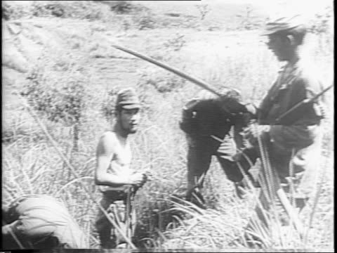 vídeos de stock e filmes b-roll de sector of ipo dam / us soldiers with filipino soldier in field / troops going through field / soldier carrying loud speaker and setting it up /... - aparelhagem de áudio