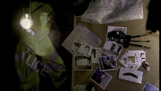 stockvideo's en b-roll-footage met 5 men found guilty various of objects in a darkened room including a light bulb police jacket noticeboard and handcuffs - bewegingsbeperkende middelen