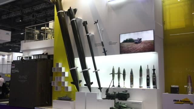 security and weapons companies gather at defence and security equipment international exhibition in excel london london uk on thursday september 12... - 陳列ケース点の映像素材/bロール