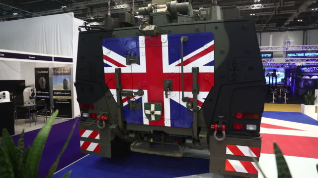 vídeos de stock e filmes b-roll de security and weapons companies gather at defence and security equipment international exhibition in excel london london uk on thursday september 12... - cristaleira