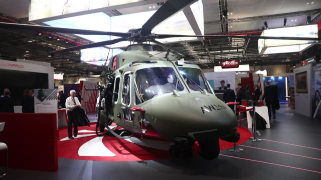 security and weapons companies gather at defence and security equipment international exhibition in excel london london uk on thursday september 12... - military helicopter stock videos & royalty-free footage