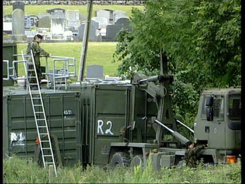 security at drumcree ahead of orange parade northern ireland portadown army transporter lorries towards along road gv army vehicle in field as... - northern ireland stock videos & royalty-free footage