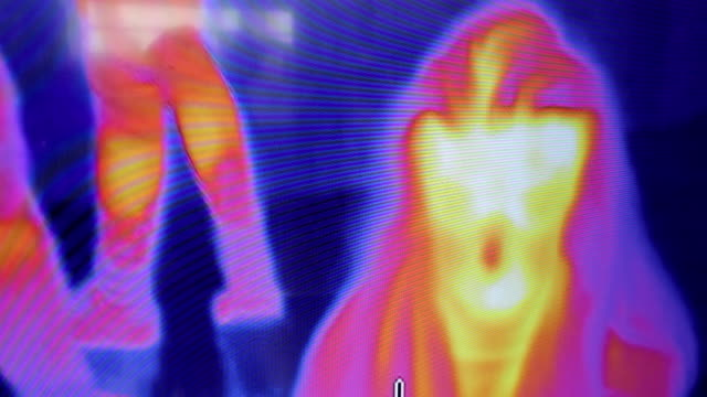 security at the airport thermal camera - stock video - thermal imaging stock videos & royalty-free footage