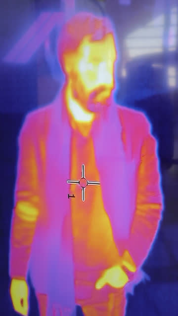 security at the airport thermal camera - vertical - stock video - thermal imaging stock videos & royalty-free footage