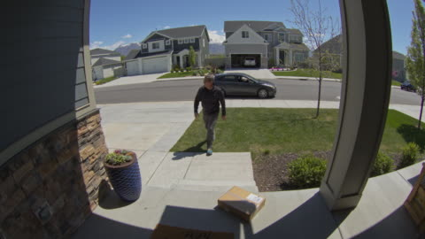 security camera footage of man stealing package from front stoop / lehi, utah, united states - stealing crime stock videos & royalty-free footage
