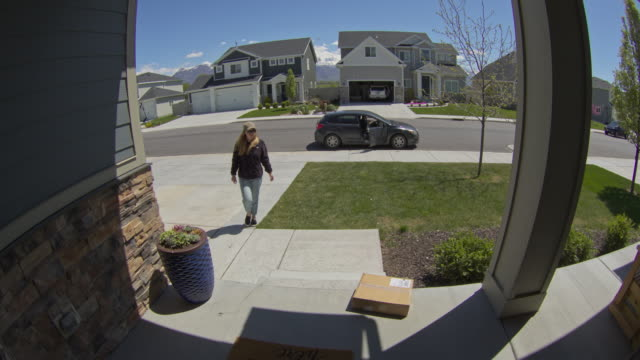security camera footage of startled thief running from front stoop / lehi, utah, united states - lehi stock videos & royalty-free footage