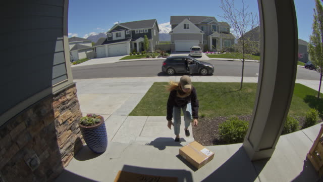security camera footage of woman stealing package from front stoop / lehi, utah, united states - porch stock videos & royalty-free footage