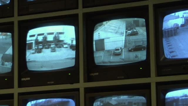 ms, pan, security camera monitors, compton, california, usa - 物の集まり点の映像素材/bロール