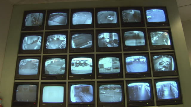 MS, Security camera monitors, Compton, California, USA