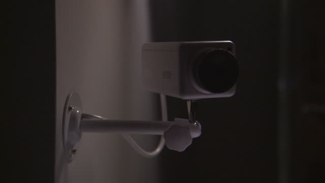 cu pan security camera mounted on wall / burlington, vermont, usa - big brother orwellian concept stock videos & royalty-free footage