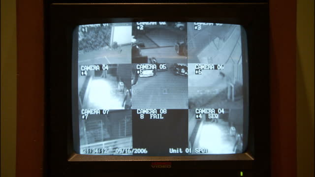 CU ZI Security camera showing people walking in office building / Los Angeles, California, USA