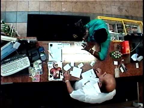oh ms security camera view of woman buying scratch-off tickets and scratching them off on convenience store countertop/ brooklyn, new york - scratch card stock videos & royalty-free footage