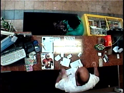 stockvideo's en b-roll-footage met oh ms security camera view of woman scratching scratch-off ticket in convenience store, winning, and doing dance/ brooklyn, new york - loterij kansspel