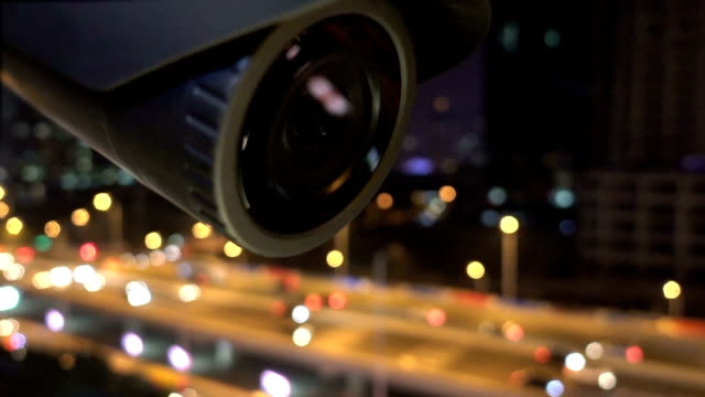 security cctv camera monitoring view of city night - film camera stock videos & royalty-free footage