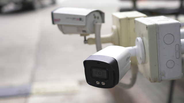 security cctv camera on road. - scrutiny stock videos & royalty-free footage