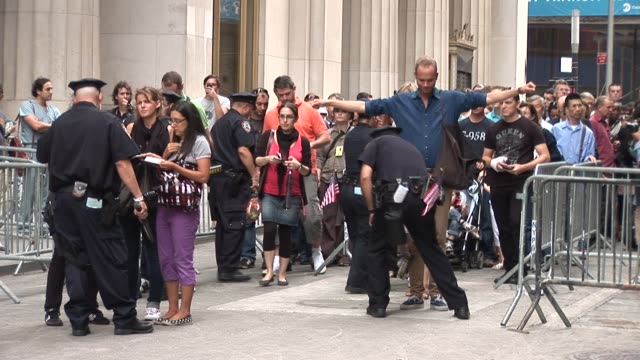 Security checkpoint at Ground Zero / Dey St Between Broadway and Church / Police scan visitors and check baggage / Visitors with backpacks are turned...