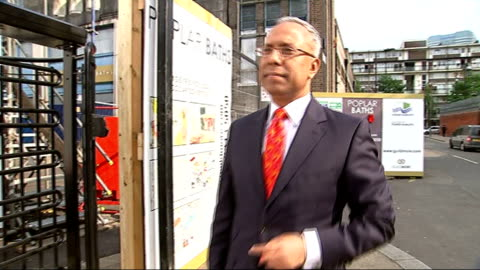 security checks in place for tower hamlets mayoral election; tower hamlets: john biggs chatting to man on street 'one east end labour' red rosette... - smith tower stock-videos und b-roll-filmmaterial