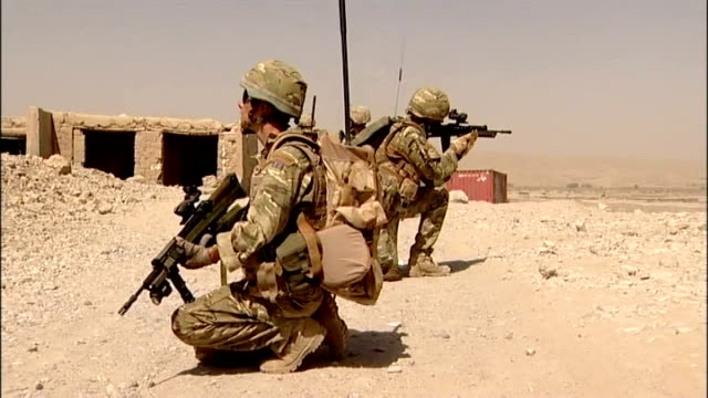 security control for sangin province handed over from britain to usa british soldiers leaving compound on patrol british troops crouched with weapons... - afghanistan stock videos & royalty-free footage