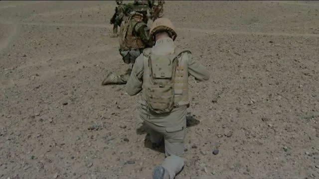 security control for sangin province handed over from britain to usa t08071029 british soldier standing at compound wall with rocket launcher on... - running shorts stock videos & royalty-free footage