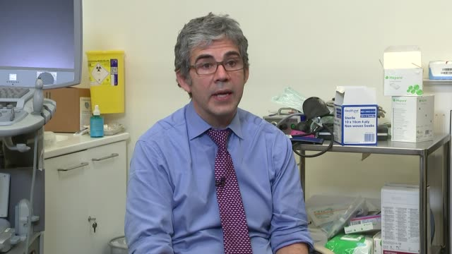 un security council vote unanimously to adopt resolution and call for ceasefire england int dr david nott interview sot - ラゲ オマール点の映像素材/bロール