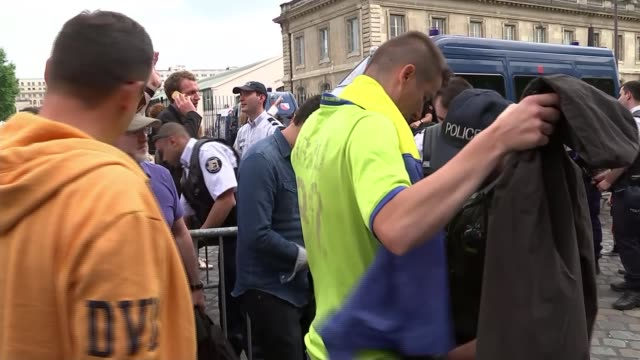 security england fans involved in clashes as tournament begins france ext various of armed police gendarmes searching football fans as they enter... - searching stock videos and b-roll footage