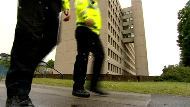 security firms to bid for contracts to take over some police work guildford ext low angle shot of two officers walking past surrey police hq zoom in... - guildford stock videos and b-roll footage