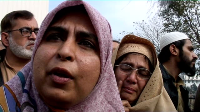 security force crackdown amina massoud interview sot want our husbands and sons back relatives of missing people gathered outside court holding... - human back stock videos & royalty-free footage