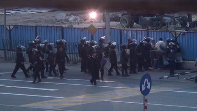 security forces advance on protestors under heavy gunfire near tahrir square during the day of rage protest on january 28, 2011 in cairo, egypt. the... - revolution stock videos & royalty-free footage