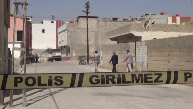 Security forces condon off the yard of a mosque's boarding house where a mortar shell is seen after two mortar bombs landed in a Turkish residential...